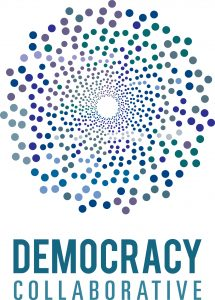 Logo for the Democracy Collaborative. Coloured dots in torus pattern.